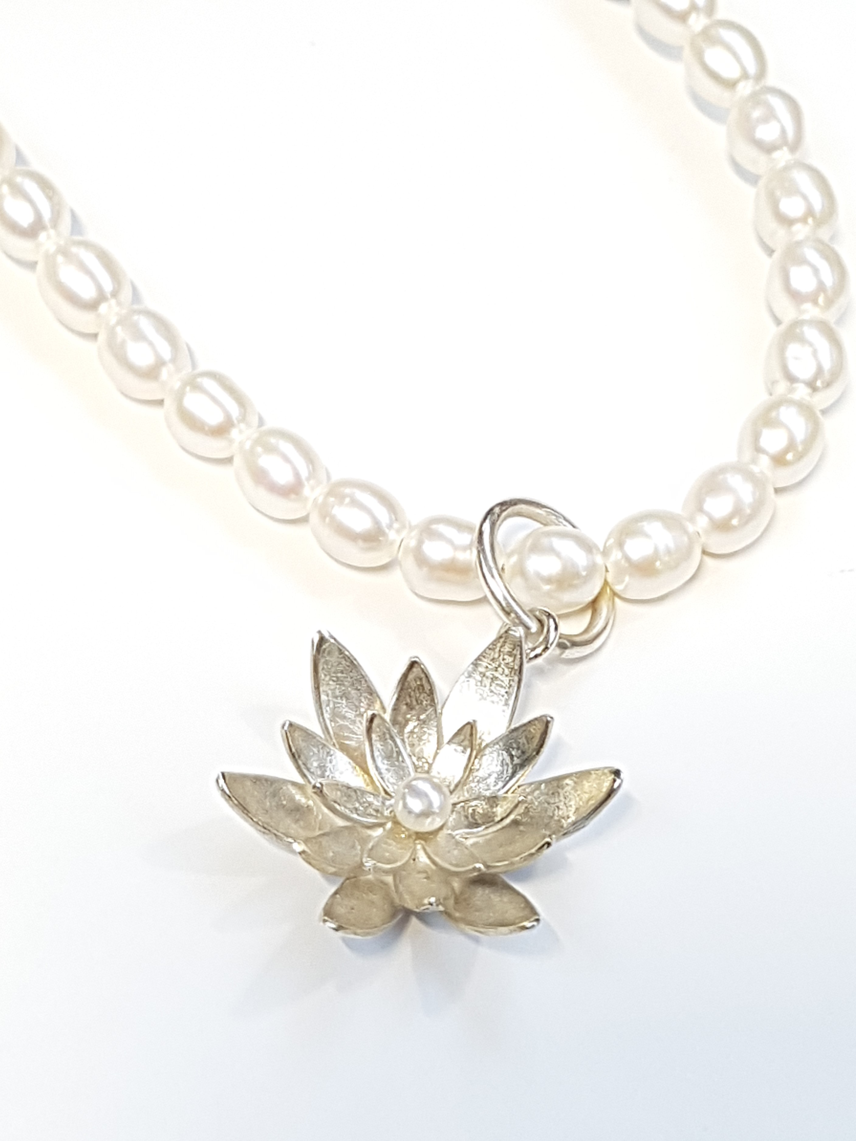 Water lily freshwater pearl necklace with sterling silver flower water lily freshwater pearl necklace with sterling silver flower pendant aloadofball Gallery